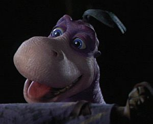 Dino is one of the amazing creations from Jim Henson's Creature Shop. Originally meant to be a man in a suit, it was later decided to have a CGI full body and a hand puppet for closeups.