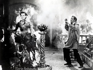 Jarrod (Vincent Price) watches in horror as his work goes up in smoke. One of the best scenes in House of Wax