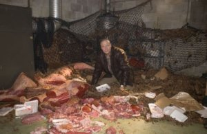 Grant (Michael Rooker) surrounded by tons and tons of meat after he gets infected