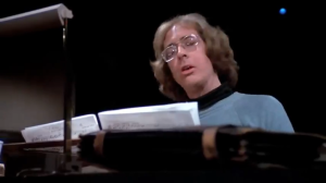 William Finley as Winslow who is composing his cantata that would later be mangled...