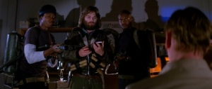 MacReady (Kurt Russell) tests to see who is truly the Thing in this classic scene