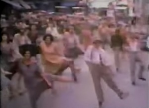 """A rare shot from the unused """"Easy Street"""" sequence that was replaced with the one in the final version as three villains dancing with street folks was thought to be """"overstuffed."""" Some snippets appeared in a behind the scenes special called""""Lights! Camera! Annie!"""" along with the making of this scene"""