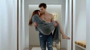 Jamie Dornan and Dakota Johnson share an intimate moment while unaware of the sequels that lie ahead....