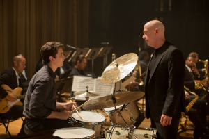 "A confrontation of egos as Miles and Simmons play at each other in  ""Whiplash"""