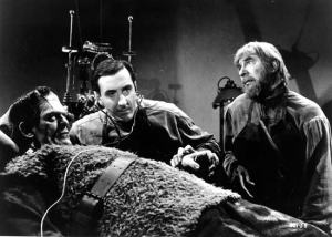 Wolf von Frankenstein (Basil Rathbone) marvels at his dad's creation while Ygor (Bela Lugosi) thinks other wise....