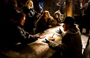 Tarantino setting up the dinner scene in the little lodge where most the movies takes place